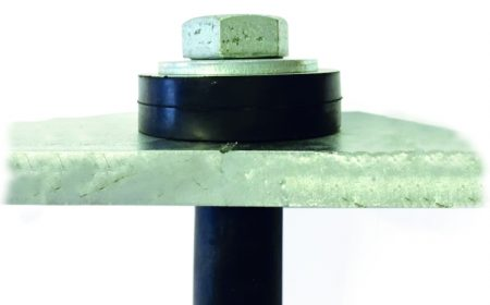 Farrat AWR Acoustic Washer used in a bolt-through connection that requires acoustic isolation